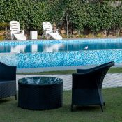 Outdoor view by the pool at Safe House Wellness Retreat India