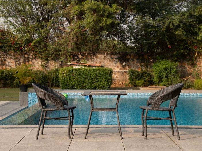 Poolside table and chairs at the Safe House