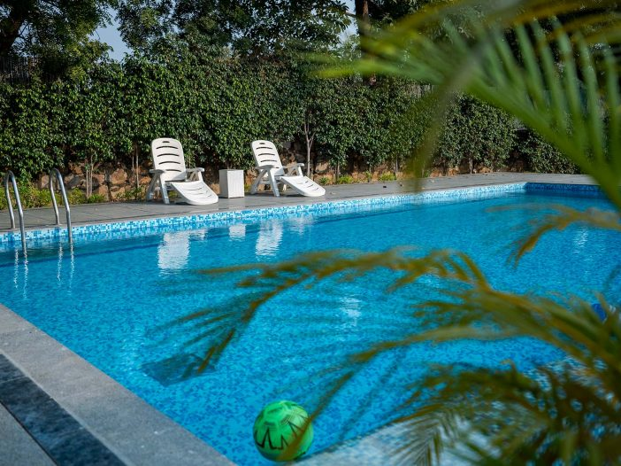 Poolside view at Safe House Wellness Retreat India